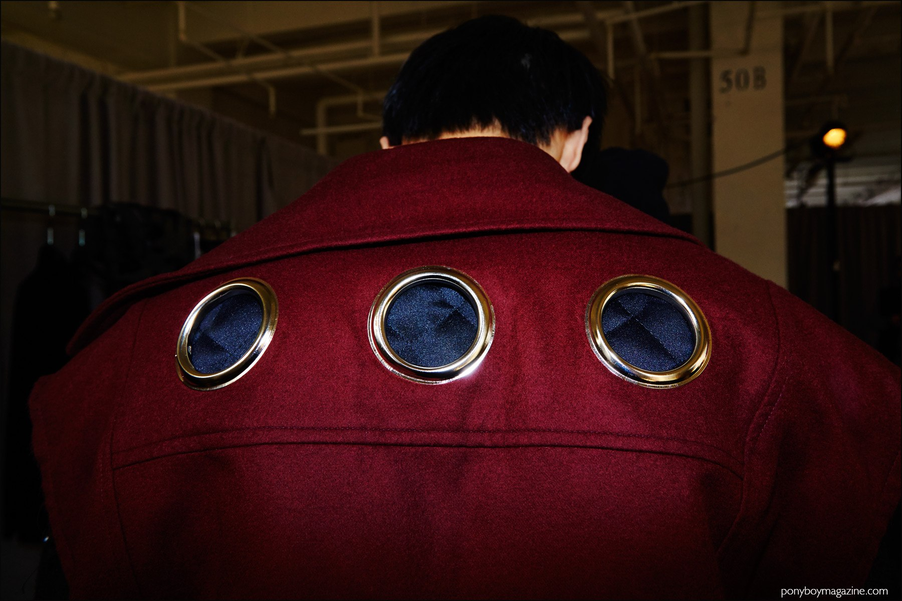 Details of metal grommets on the back of a men's vest, backstage at Kenneth Ning F/W16 menswear show. Photography by Alexander Thompson for Ponyboy magazine NY.