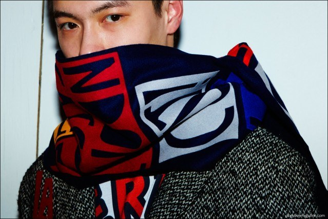 Close-up shot of a male model wearing a graphic scarf, backstage at the Libertine F/W16 show. Photographed by Alexander Thompson for Ponyboy magazine.