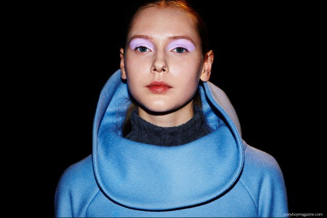 A model in an exaggerated collar, photographed backstage at Milly F/W16 womenswear show. Photography by Alexander Thompson for Ponyboy magazine.