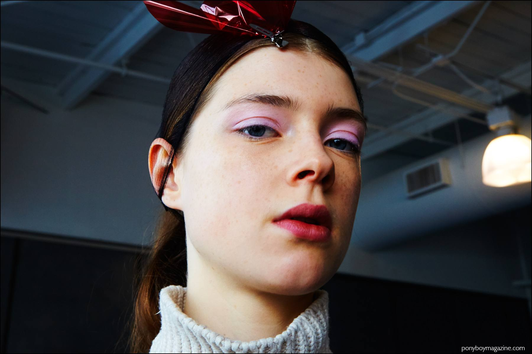 A model backstage in hair & makeup at Milly F/W16 womenswear show. Photography by Alexander Thompson for Ponyboy magazine.