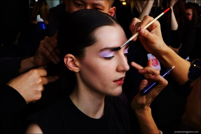 Brunette model Danielle Dorchester photographed in makeup, backstage at the Milly F/W16 womenswear show. Photography by Alexander Thompson for Ponyboy magazine.