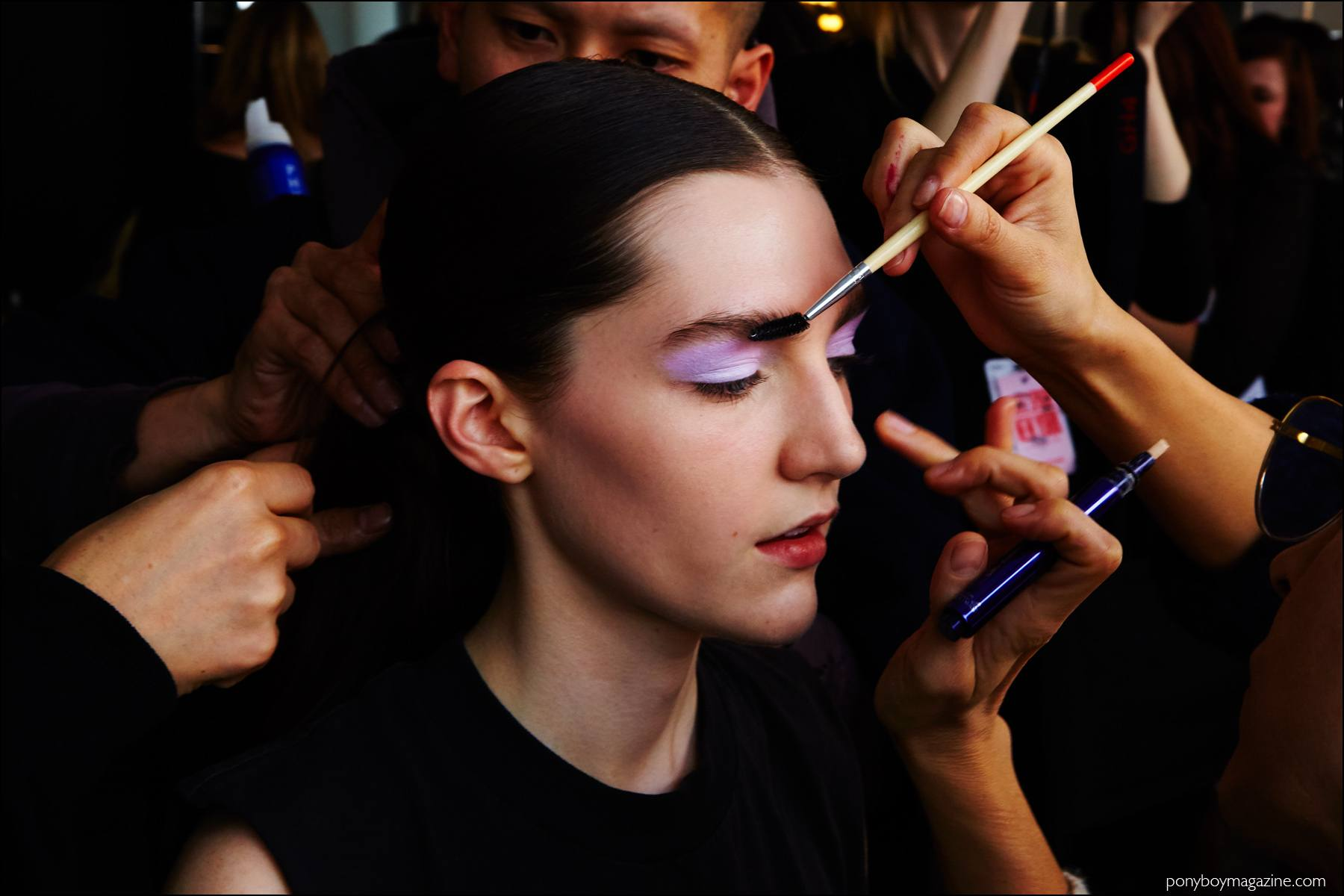 Brunette model Danielle Dorchester photographed in makeup, backstage at the Milly F/W16 womenswear show. Photography by Alexander Thompson for Ponyboy magazine NY.