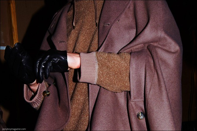 Detail shot of a black leather gloves and cape, backstage at Robert Geller F/W16 menswear show. Photography by Alexander Thompson for Ponyboy magazine.