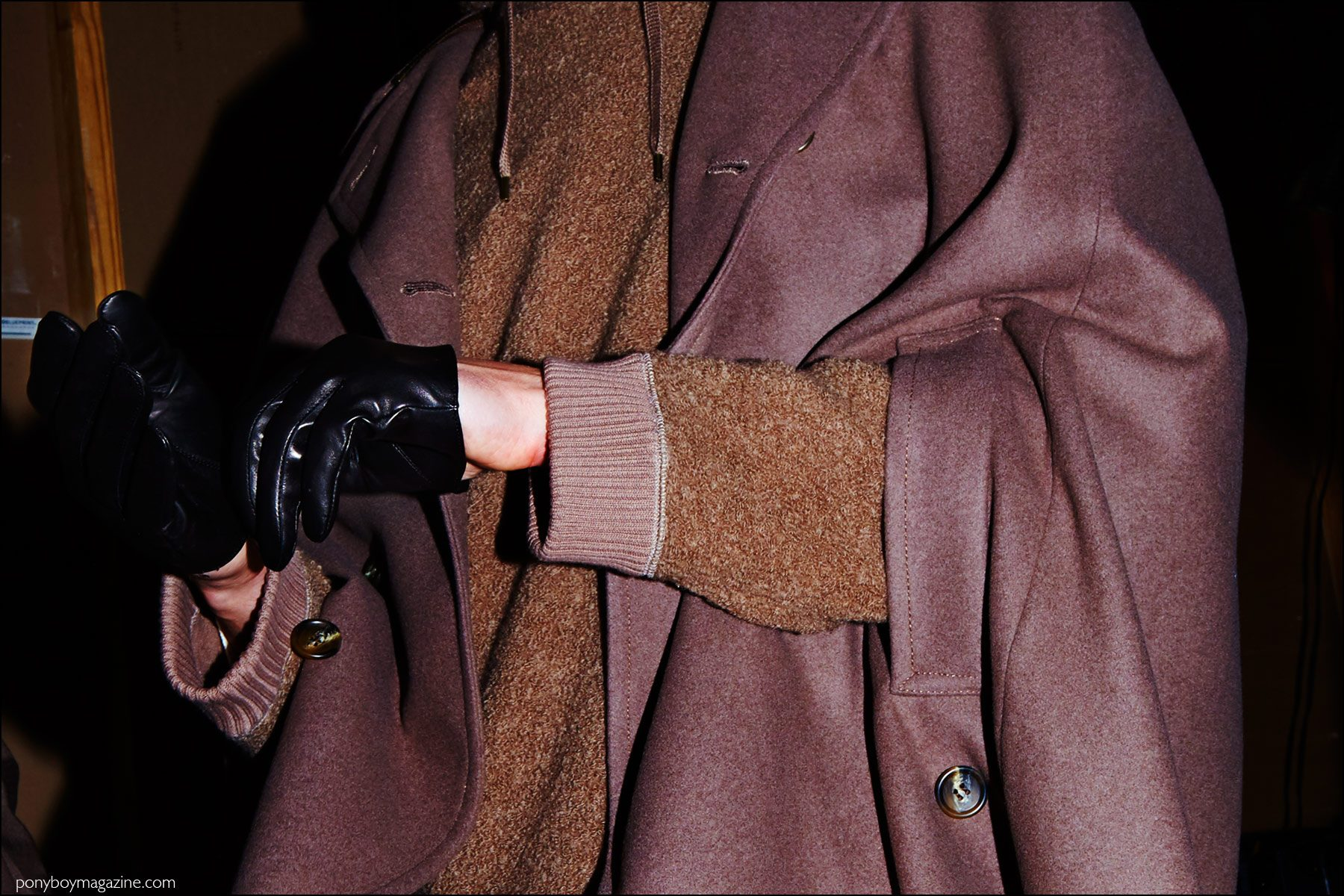 Detail shot of a black leather gloves and cape, backstage at Robert Geller F/W16 menswear show. Photography by Alexander Thompson for Ponyboy magazine NY.