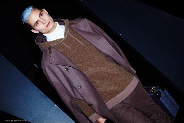 Male model Paul-Alexandre Haubtmann exits the runway, backstage at Robert Geller F/W16 menswear show. Photography by Alexander Thompson for Ponyboy magazine.