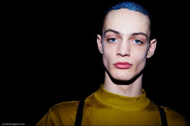 Model Charlie James photographed backtage at Robert Geller F/W16 menswear show. Photography by Alexander Thompson for Ponyboy magazine.