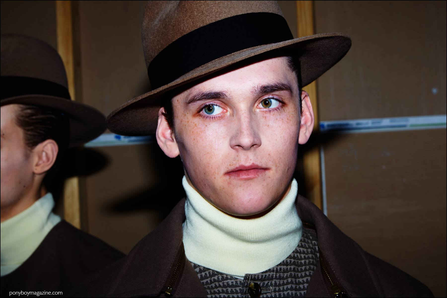 Model Anders Hayward wears a fedora, backstage at Robert Geller F/W16 menswear show. Photography by Alexander Thompson for Ponyboy magazine NY.