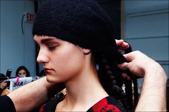 A model gets her head wrap adjusted, backstage at the A Détacher Fall 2016 womenswear show. Photography by Alexander Thompson for Ponyboy magazine.
