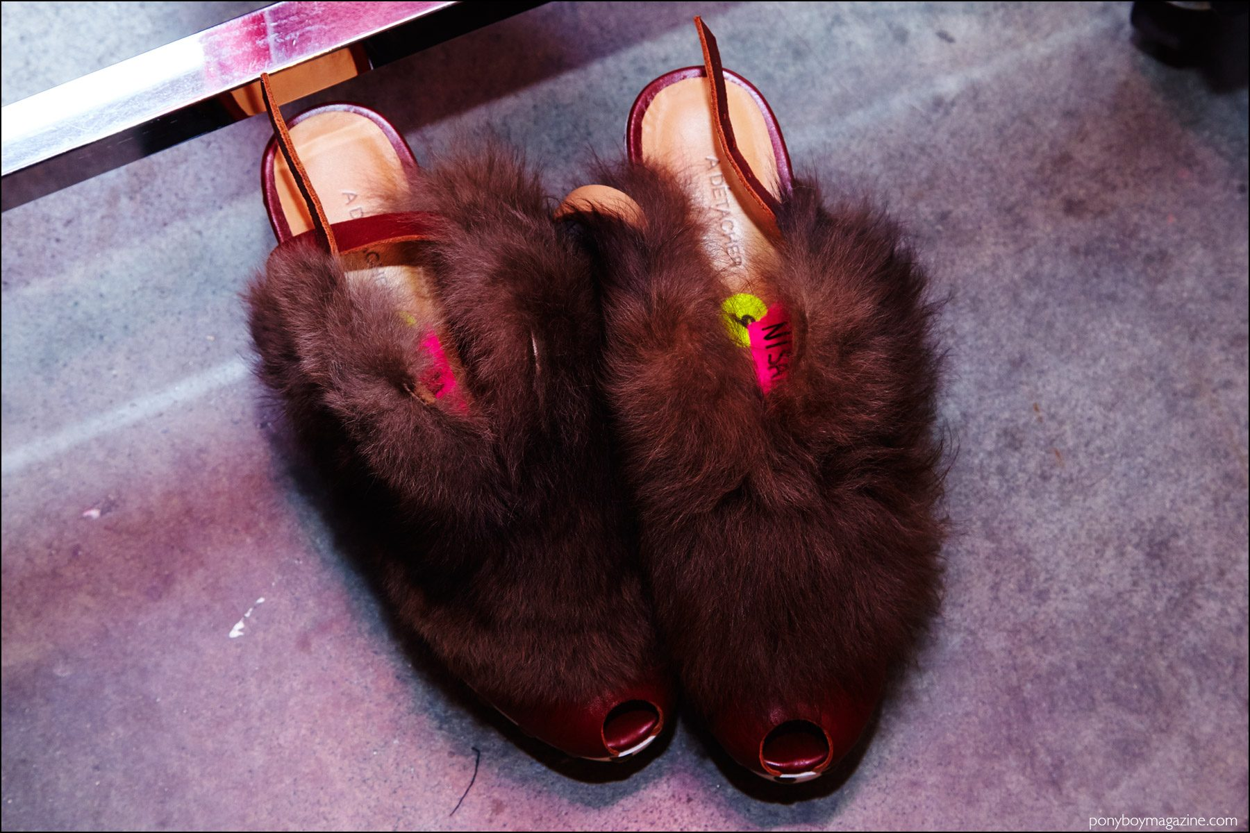 Detail shot of furry peep-toe clogs, backstage at A Détacher womenswear show. Photography by Alexander Thompson for Ponyboy magazine NY.