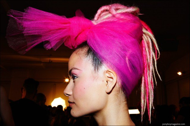 Profile photograph of a model in a pink head scarf, backstage at The Blonds F/W16 show. Photography by Alexander Thompson for Ponyboy magazine.