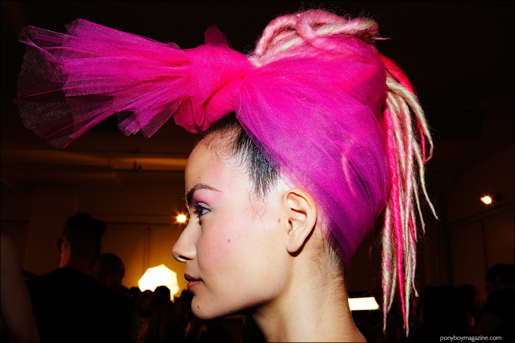 Profile photograph of a model in a pink head scarf, backstage at The Blonds F/W16 show. Photography by Alexander Thompson for Ponyboy magazine NY.