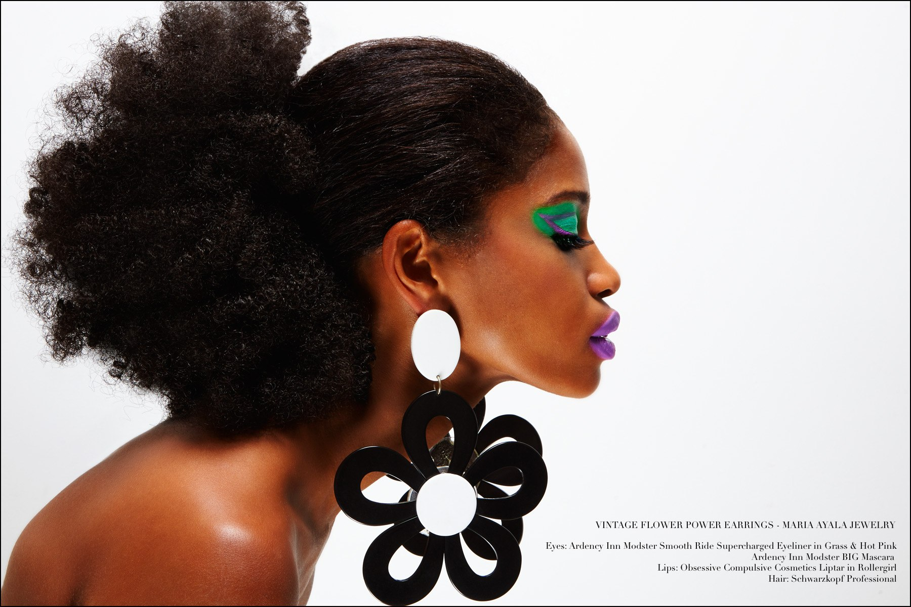 Dramatic oversized flower earrings designed by Maria Ayala, featured on model Christina Anderson-McDonald. Photography by Alexander Thompson for Ponyboy magazine NY.