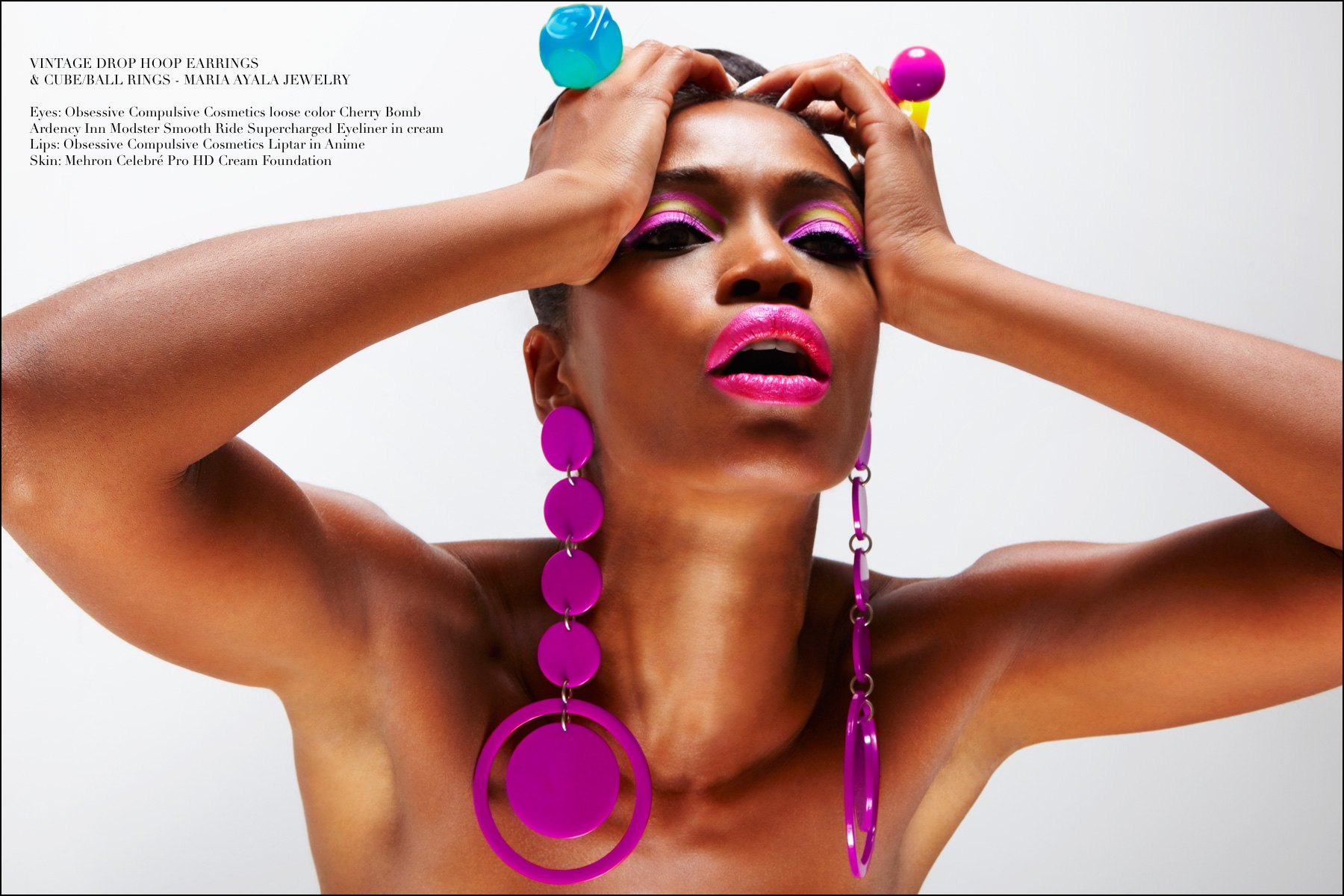 Dramatic purple hoops and oversized plastic rings modeled by Christina Anderson-McDonald, designed by Maria Ayala. Photography by Alexander Thompson for Ponyboy magazine NY.