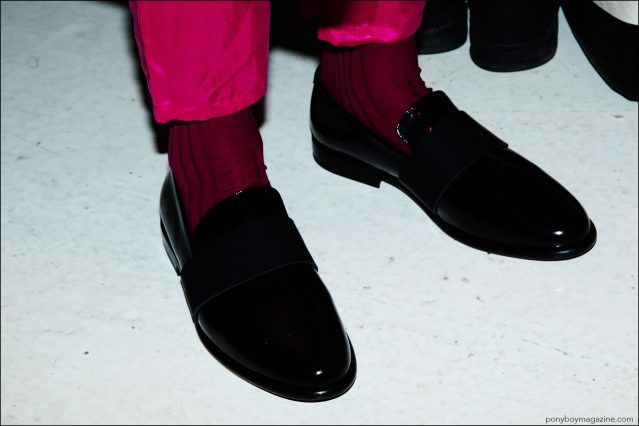 A detail shot of men's shoes and pink trousers, photographed backstage at the Robert Geller Spring/Summer 2017 menswear show. Photography by Alexander Thompson for Ponyboy magazine.