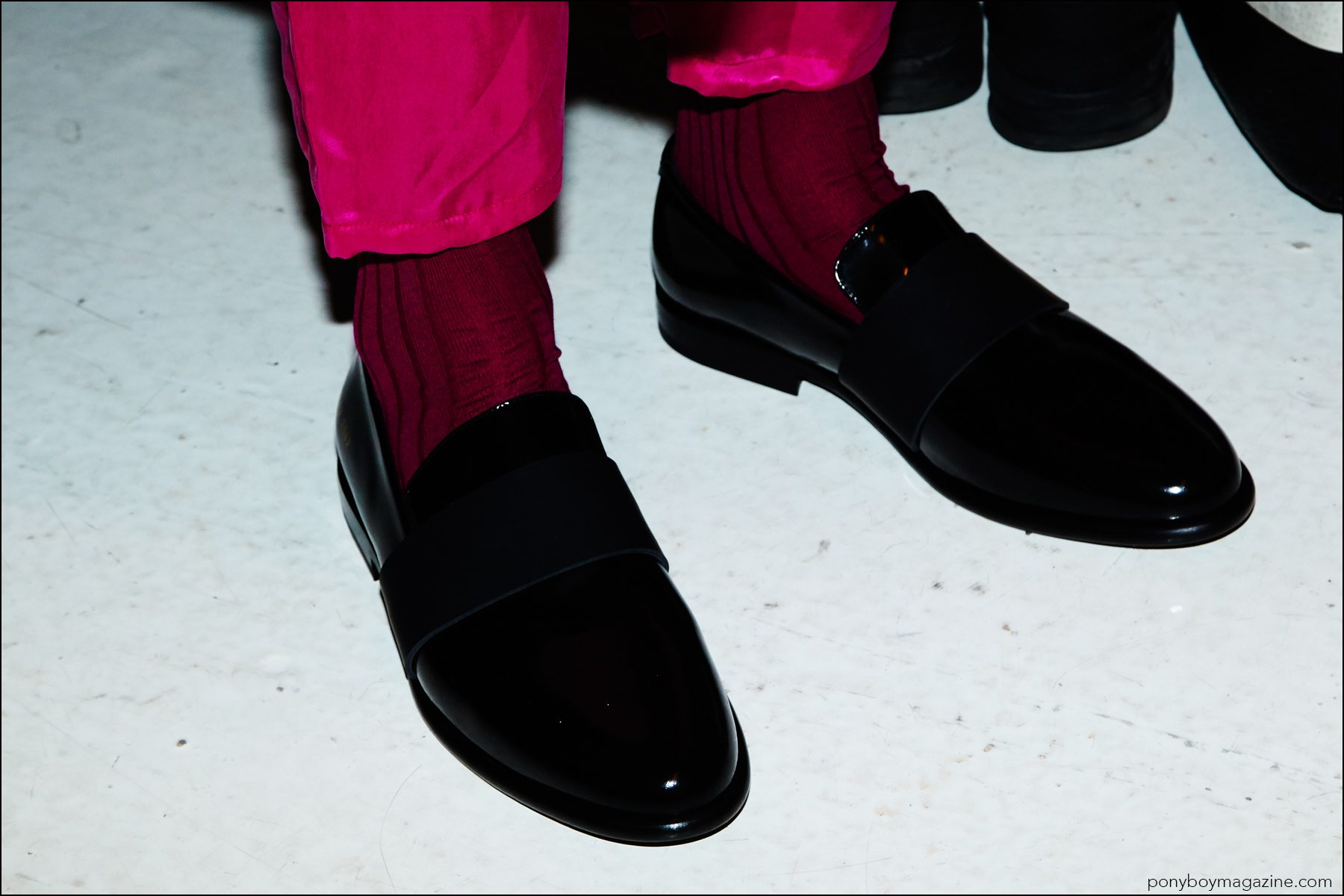 A detail shot of men's shoes and pink trousers, photographed backstage at the Robert Geller Spring/Summer 2017 menswear show. Photography by Alexander Thompson for Ponyboy magazine NY.