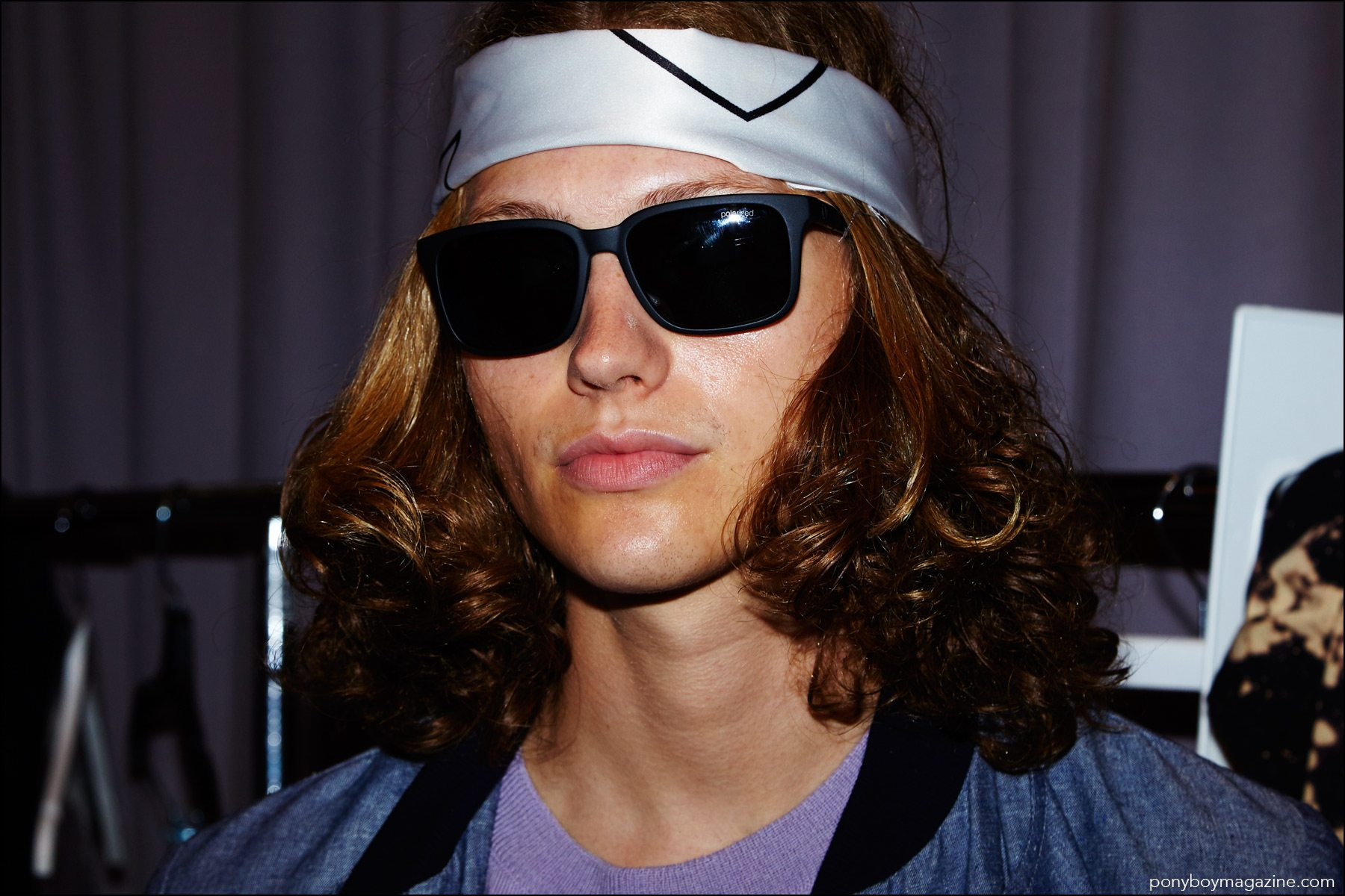 A long-haired male model snapped backstage at the Rochambeau Spring/Summer 2017 menswear show. Photography by Alexander Thompson for Ponyboy magazine NY.