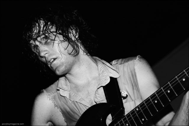 Lead singer for The Mystery Lights, Mike Brandon, photographed onstage at the Mercury Lounge in NYC. Photography by Alexander Thompson for Ponyboy magazine.