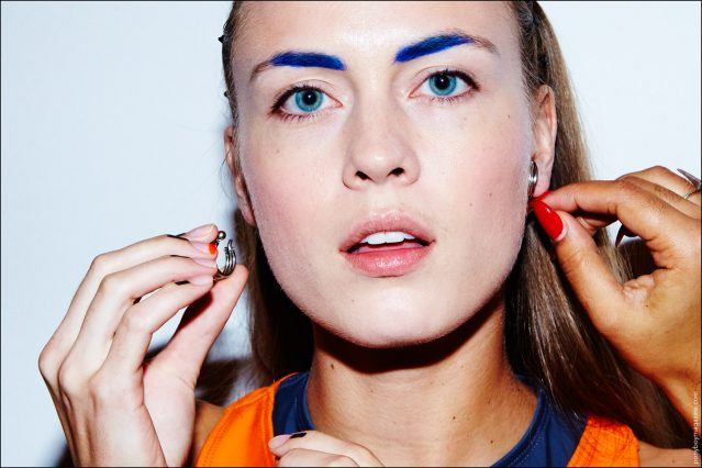 Model Sarah Robinson adjusts her jewelry, backstage at Chromat Spring/Summer 2017. Photographed by Alexander Thompson for Ponyboy magazine New York.