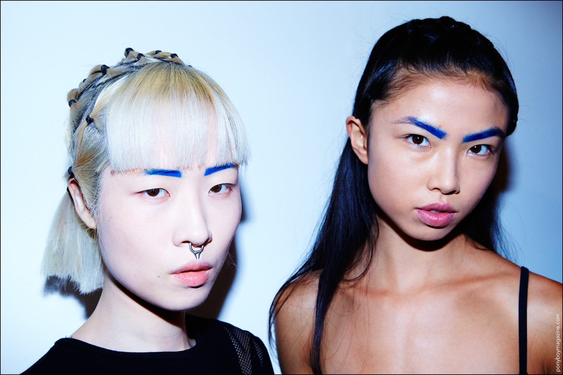 Models Shinhae Yoon & Meghan Takahashi pose for photographer Alexander Thompson, backstage at Chromat S/S17. Ponyboy magazine NY.