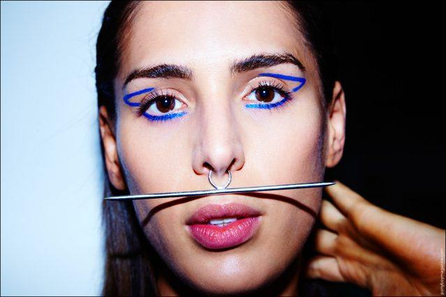 Model Carmen Carrera photographed backstage at the Chromat Spring/Summer 2017 womenswear show. Photography by Alexander Thompson for Ponyboy magazine in New York City.