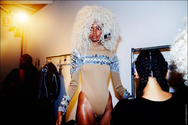 Model Djenice Duarte photographed getting dressed backstage at the Blonds Spring/Summer 2017 show at Milk Studios in New York City. Photography by Alexander Thompson for Ponyboy magazine.