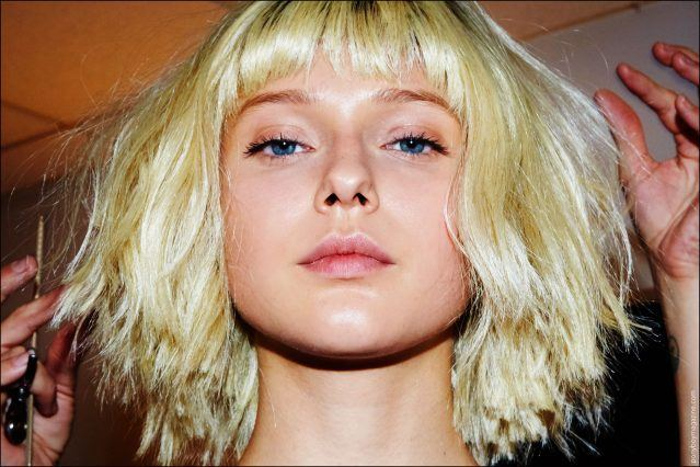 A model gets her wig trimmed, backstage at the Georgine Spring/Summer 2017 show. Photography by Alexander Thompson for Ponyboy magazine New York.