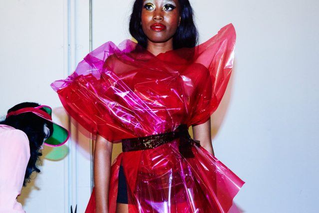 Designer Stella Rose Saint Clair fits a cellophane dress on a model. Photographed by Alexander Thompson for Ponyboy magazine in NY.