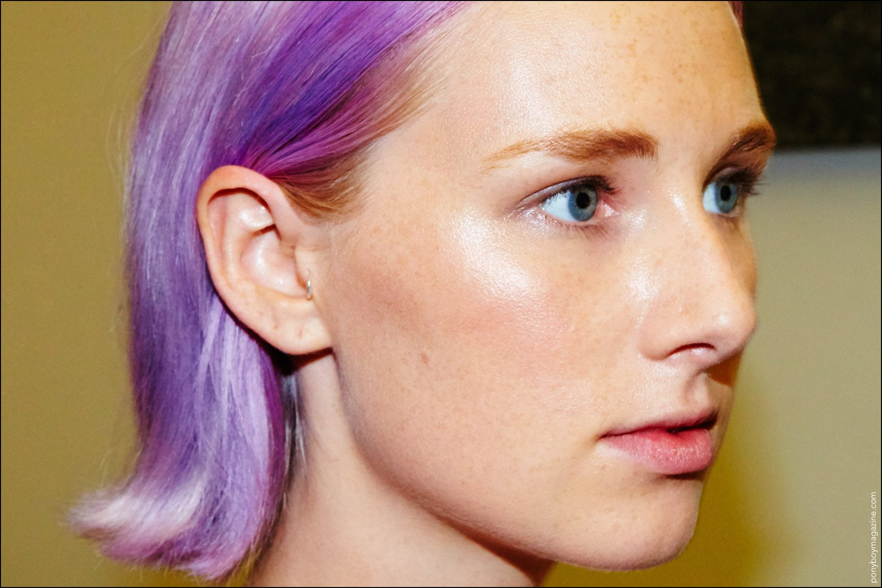 Lilac hair photographed on a young model, backstage at the threeASFOUR fashion show for Spring 2017. Photographed by Alexander Thompson for Ponyboy magazine in NY.