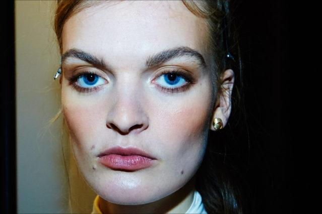 Model Juliane Grüner in makeup, backstage at the Adam Selman Fall 2017 womenswear show. Photography by Alexander Thompson for Ponyboy magazine.