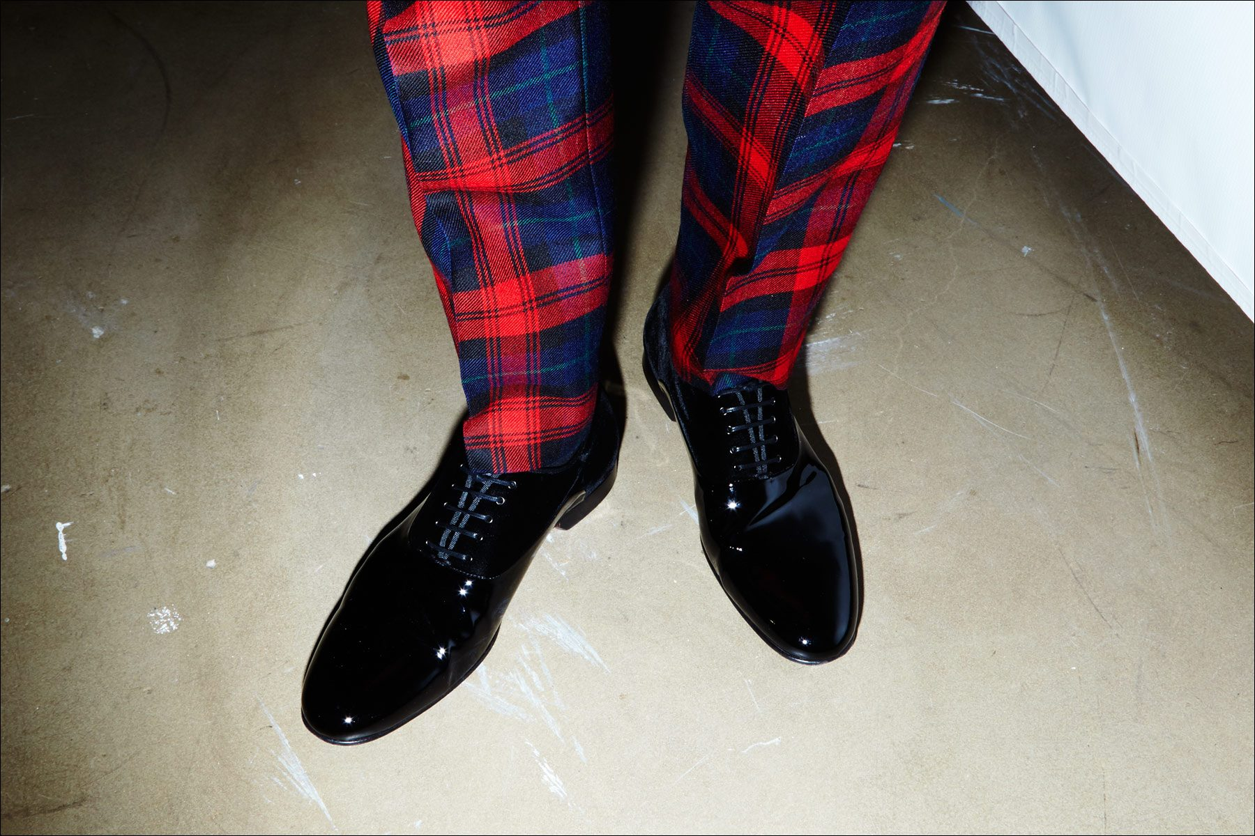 Tartan trousers worn with Johnson & Murphy dress shoes, snapped backstage at the David Hart Fall/Winter 2017 menswear show. Photography by Alexander Thompson for Ponyboy magazine.