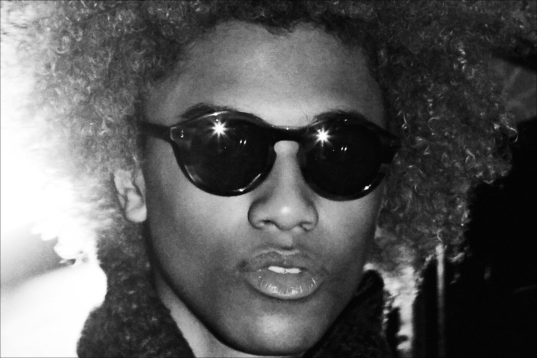 Model Michael Lockley photographed in sunglasses backstage at the John Varvatos Fall/Winter 2017 menswear show. Photography by Alexander Thompson for Ponyboy magazine NY.