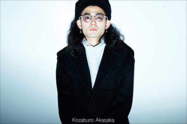 Menswear designer Kozaburo Akasaka photographed backstage by Alexander Thompson for Ponyboy magazine.