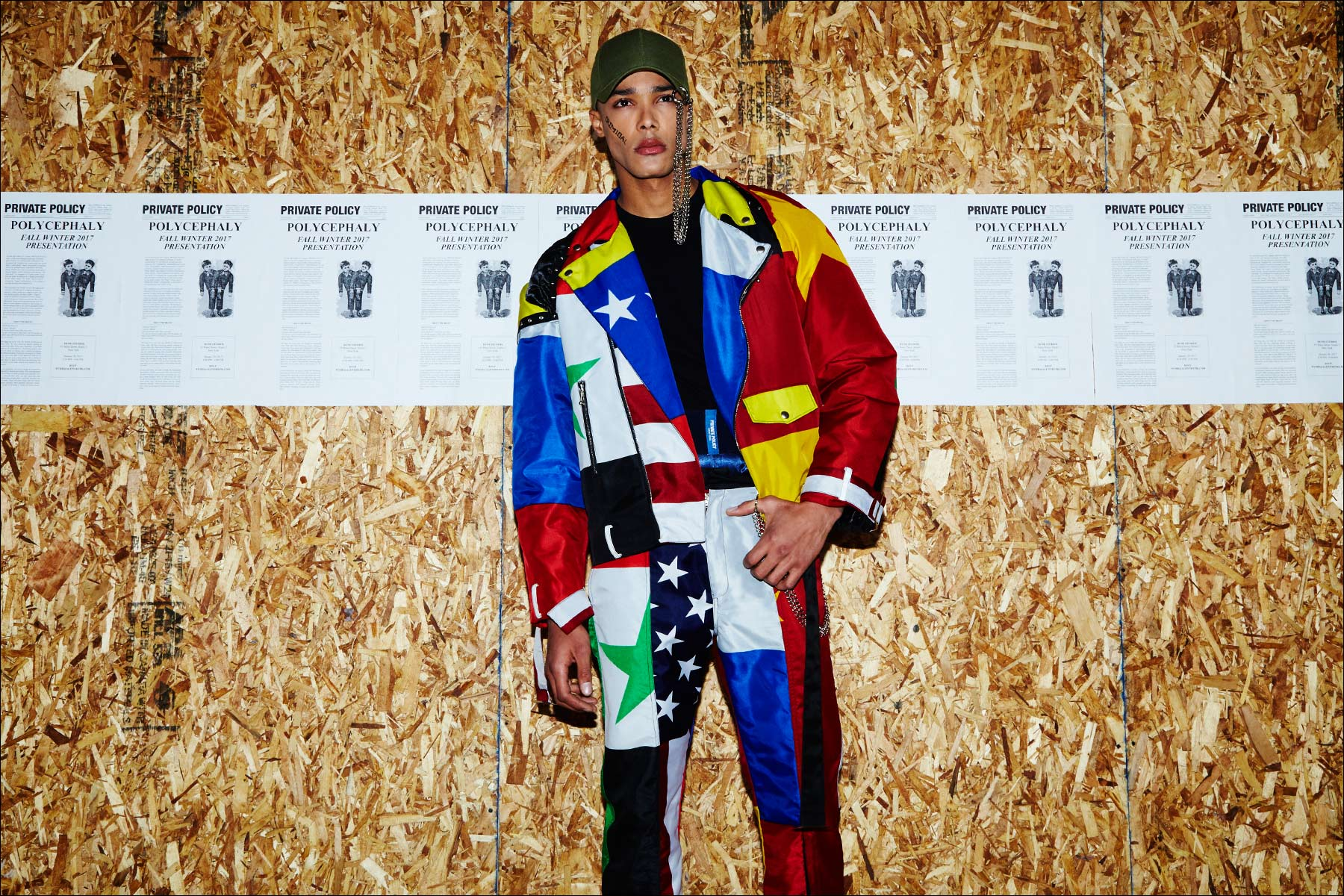 A jacket and trouser set constructed from flags on model Josh Bartley, photographed at the Private Policy F/W17 menswear presentation. Photography by Alexander Thompson for Ponyboy magazine NY.