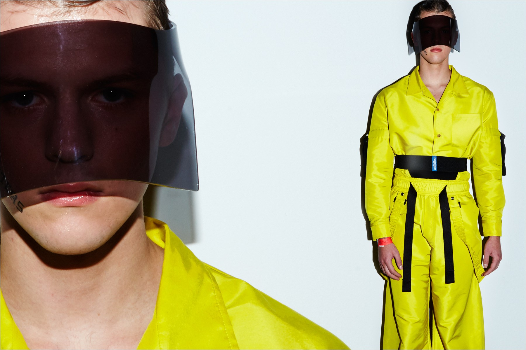 A yellow jumpsuit and plastic face mask photographed backstage on model Brandon Pikulinski at the Private Policy F/W17 menswear presentation. Photography by Alexander Thompson for Ponyboy magazine NY.