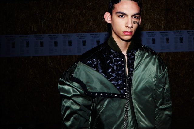 Male model Damien Medina in a satin bomber jacket, backstage before the Private Policy F/W17 menswear presentation. Photography by Alexander Thompson for Ponyboy magazine.