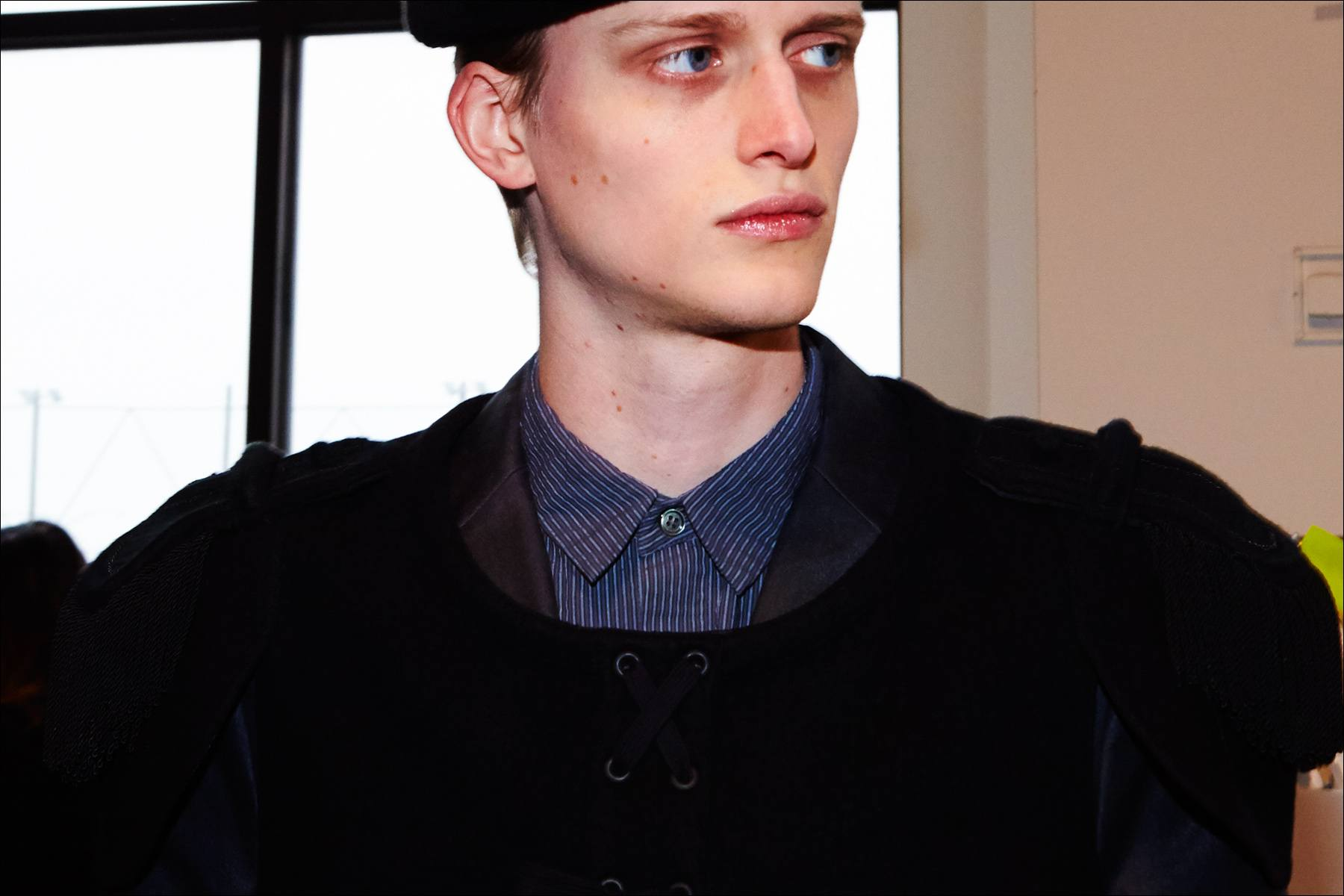 Model Alexander Newman wears an epaulet backstage at the Robert Geller A/W17 menswear show. Photographed in New York City by Alexander Thompson for Ponyboy magazine.