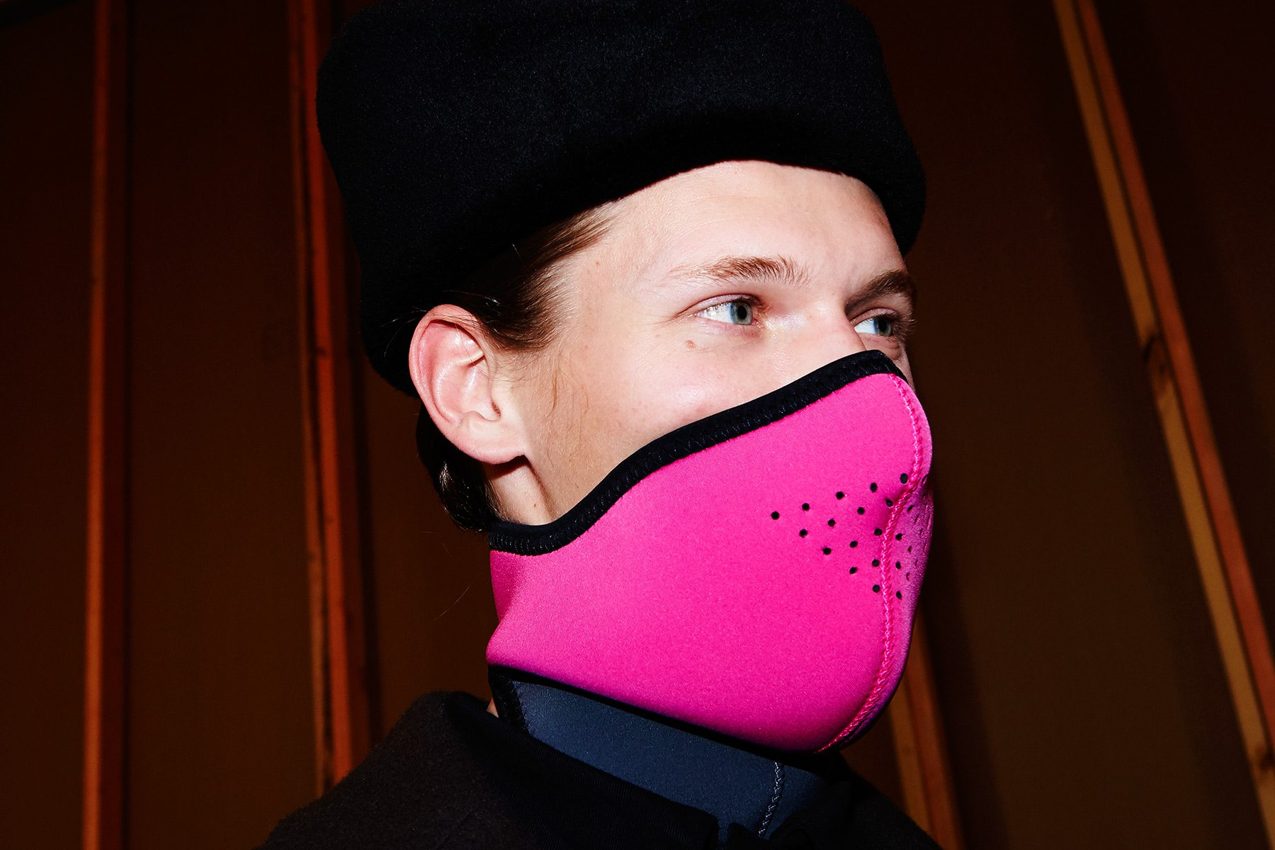 A model wears a pink ski mask, backstage at Robert Geller A/W17 menswear show. Photographed for Ponyboy magazine by Alexander Thompson in New York City.