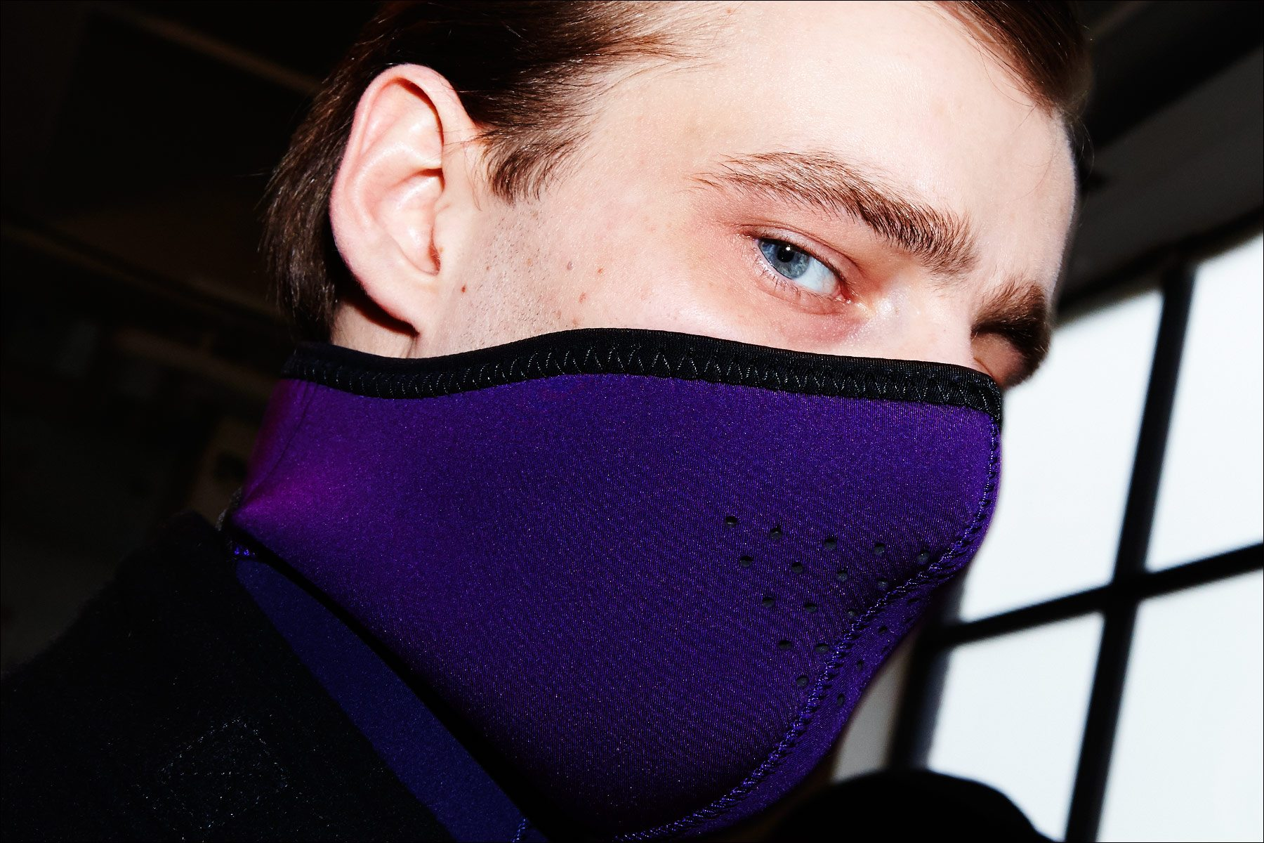 Model Laurie Harding snapped backstage in a face mask at Robert Geller Autumn/Winter 2017 menswear show. Photographed by Alexander Thompson for Ponyboy magazine NY.