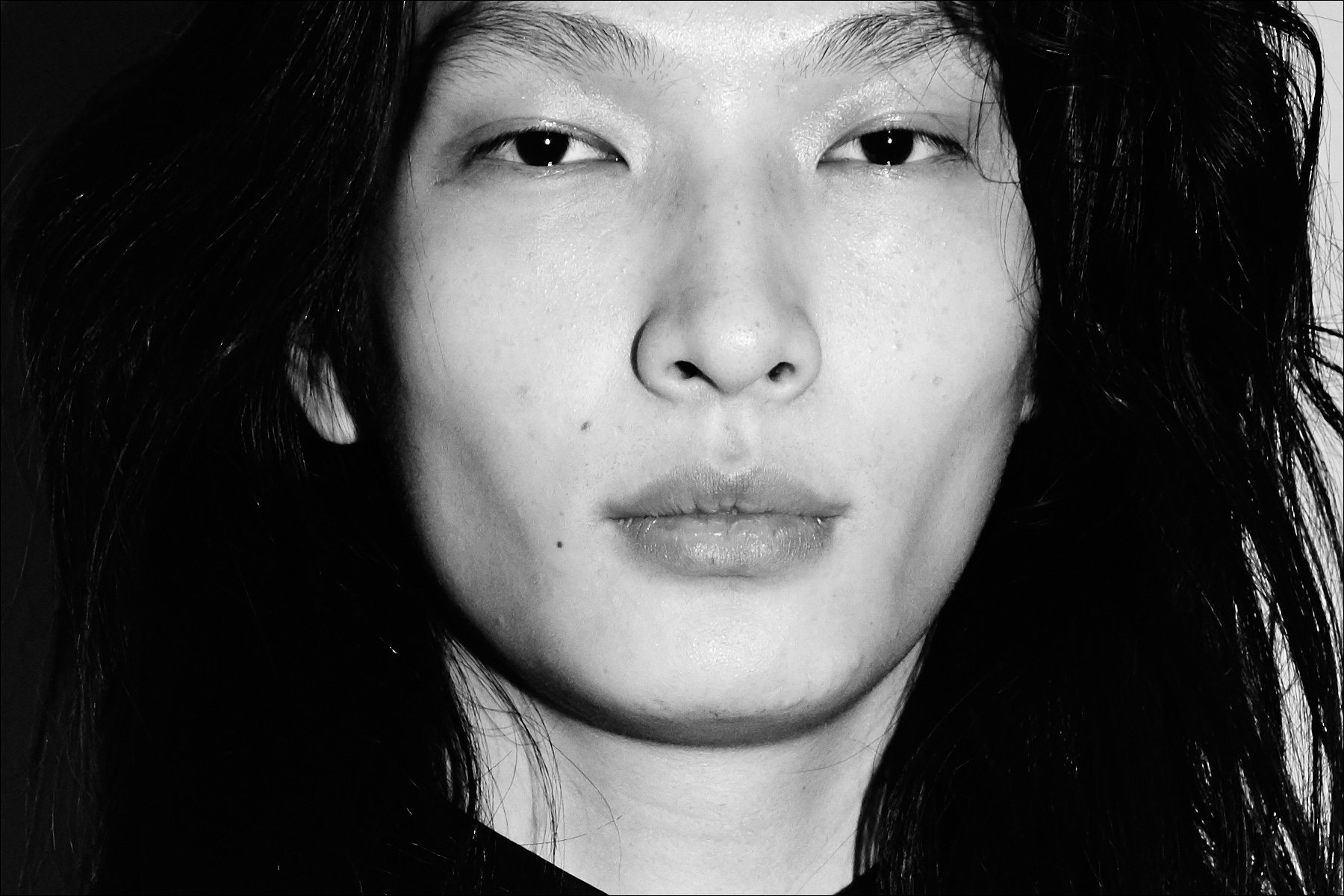 A close-up shot of model Zhengyang Zhang, backstage at the Carlos Campos F/W17 menswear show. Photographed by Alexander Thompson for Ponyboy magazine New York.