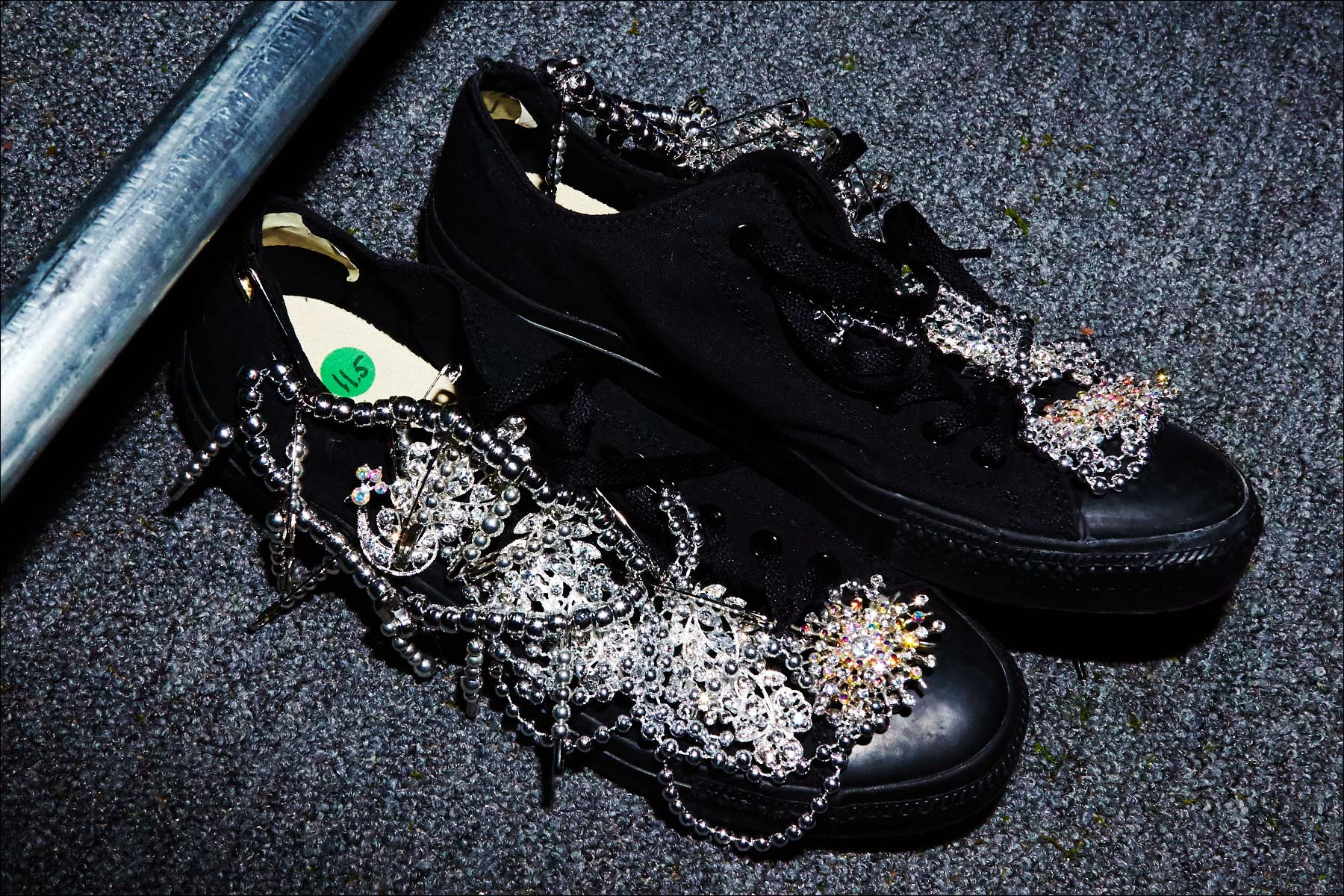 Embellished Converse sneakers photographed backstage at Libertine F/W17 collection. Photography by Alexander Thompson for Ponyboy magazine NY.