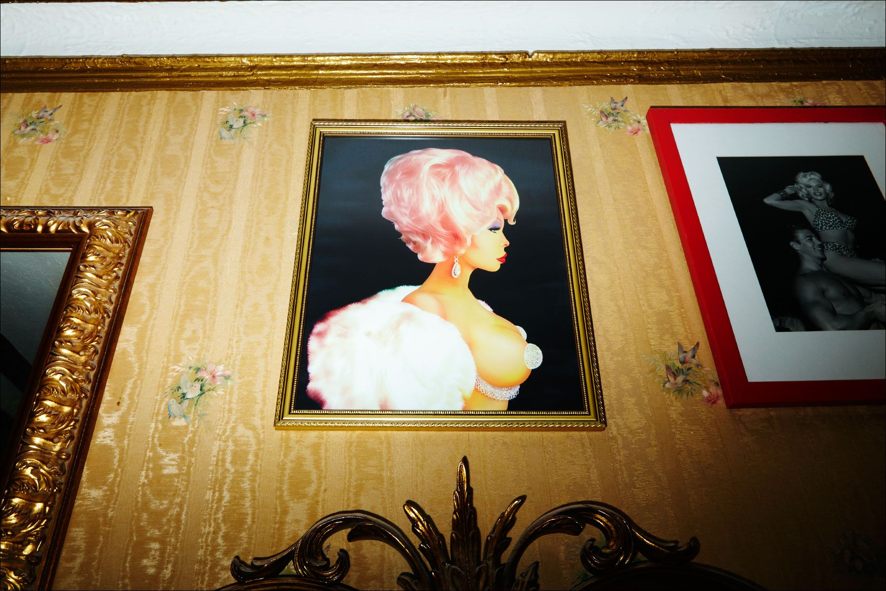 A Scott Ewalt painting of Amanda Lepore hangs in her Manhattan apartment. Photography by Alexander Thompson for Ponyboy magazine.