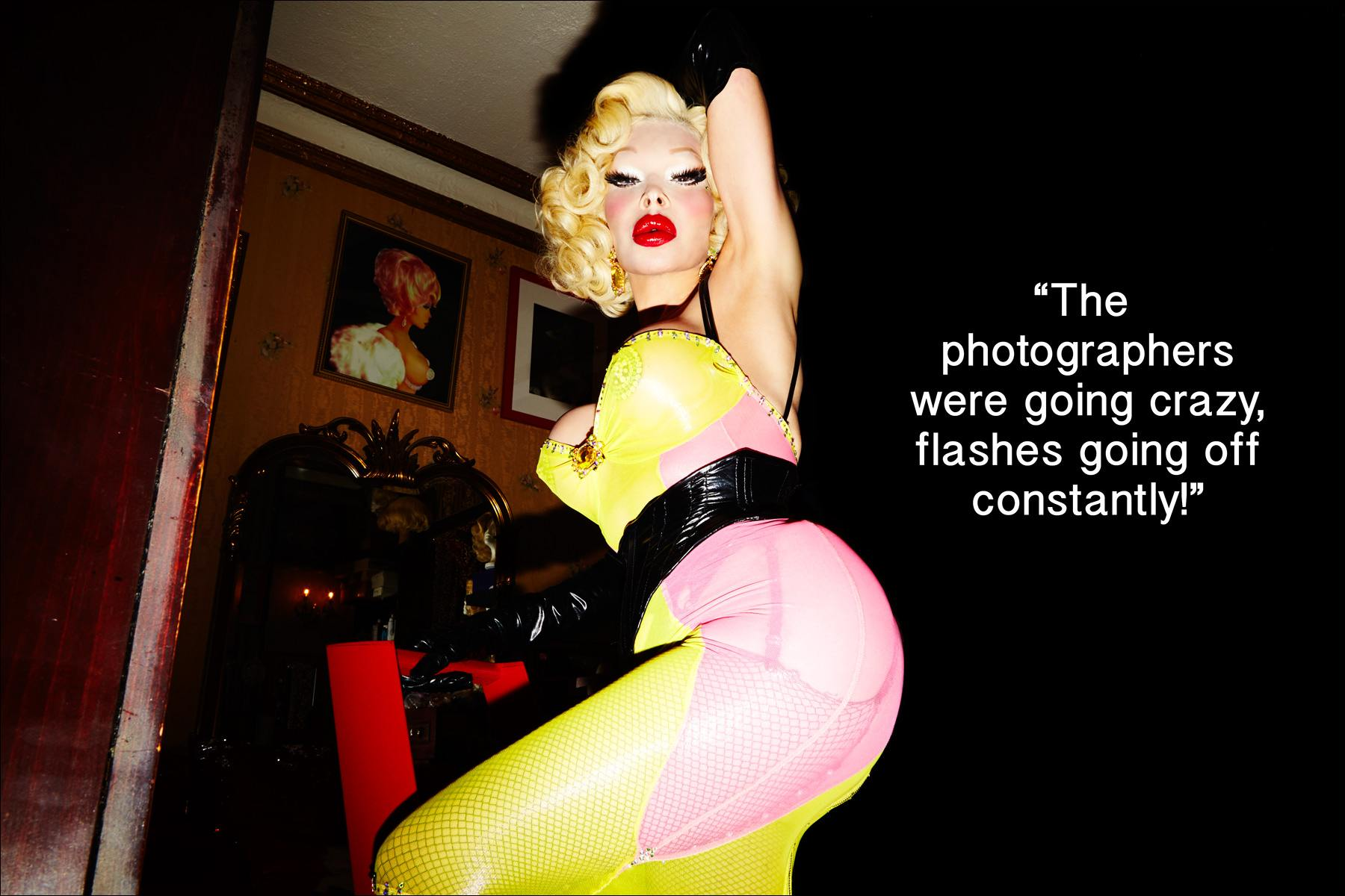 Model Amanda Lepore poses on a lader in her home in New York. Photographed by Alexander Thompson for Ponyboy magazine.