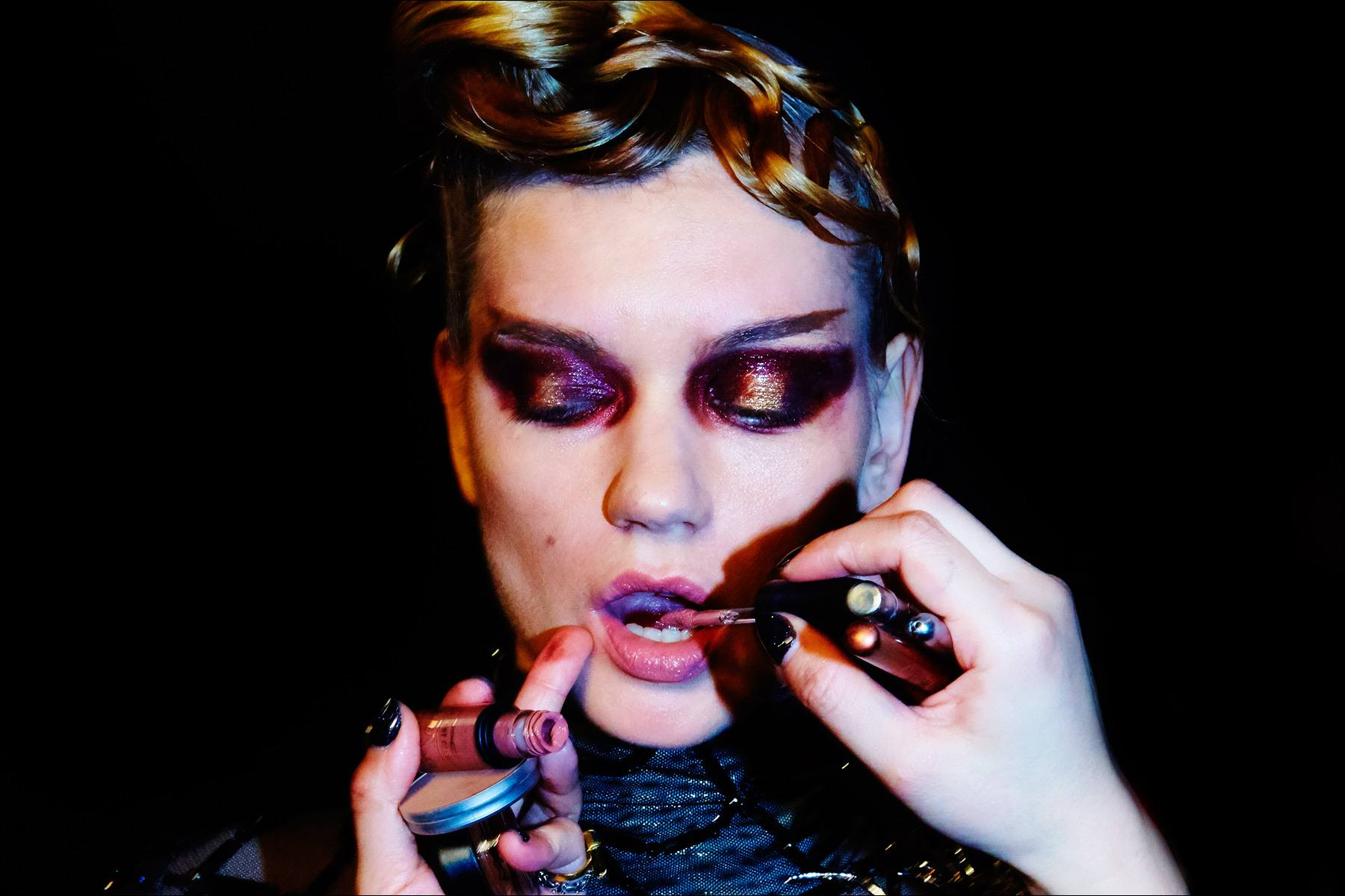 Model Lyoka Tyagnereva has her makeup retouched before walking for The Blonds Fall 2017 womenswear runway show. Photography by Alexander Thompson for Ponyboy magazine New York.