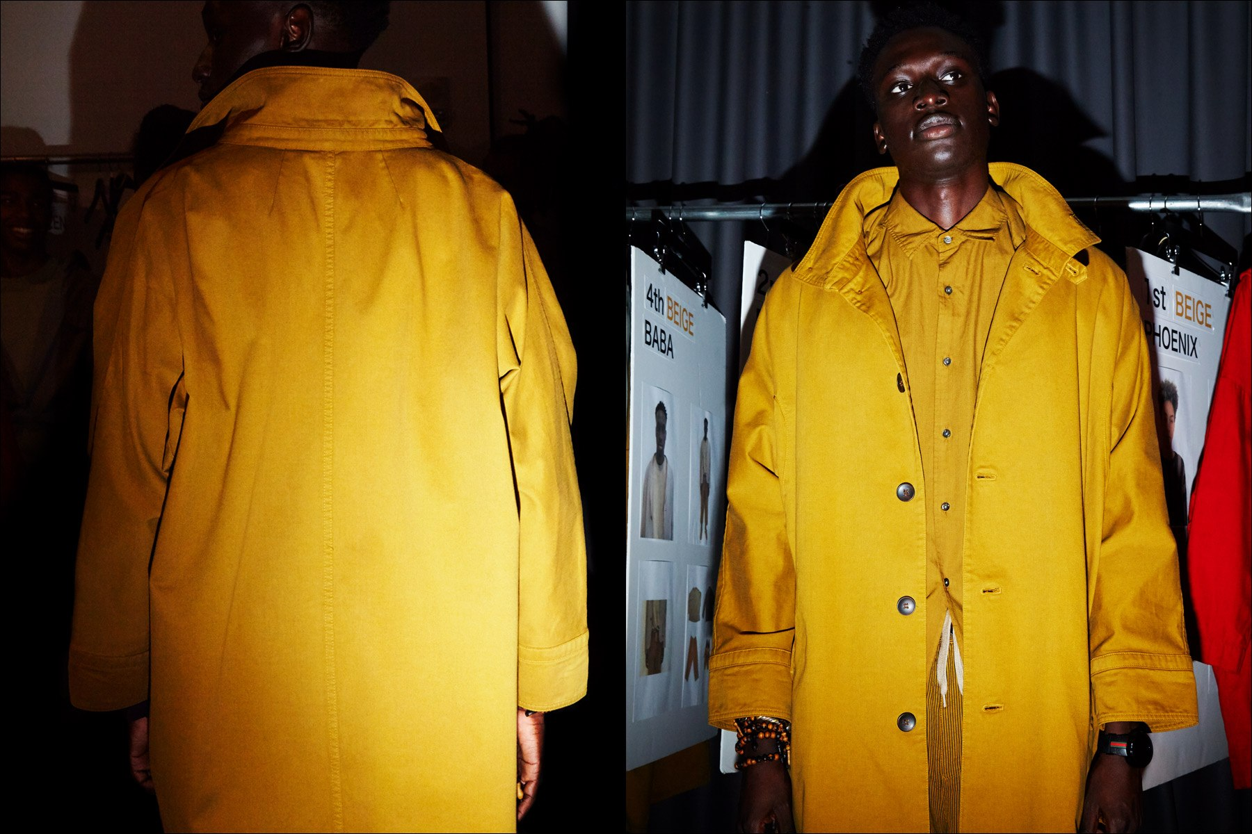A mustard trench coat snapped backstage at Gustav Von Ashcenbach Spring 2018 menswear show by designer Robert Geller. Photographed by Alexander Thompson for Ponyboy magazine NY.