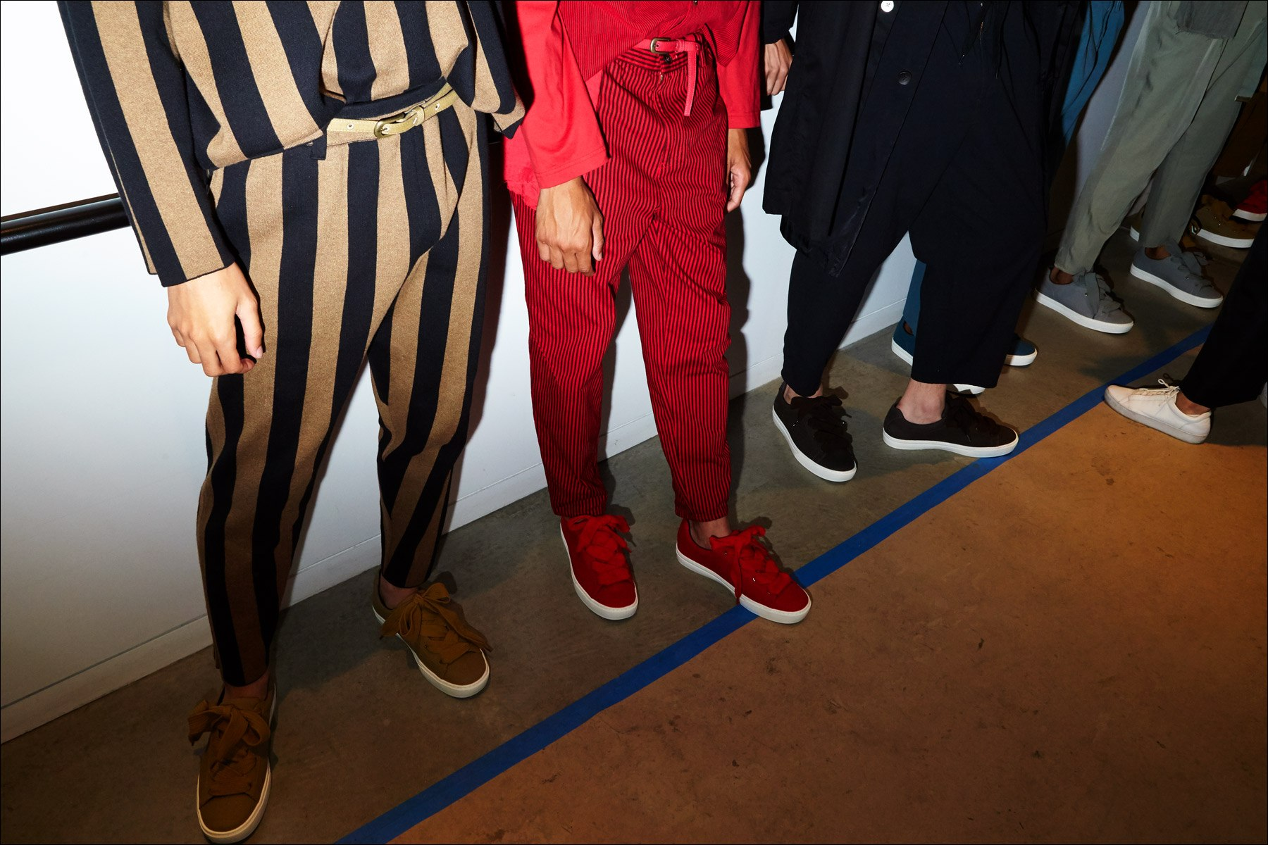 Trousers and sneakers snapped backstage at Gustav Von Ashcenbach Spring 2018 menswear show by designer Robert Geller. Photographed by Alexander Thompson for Ponyboy magazine NY.