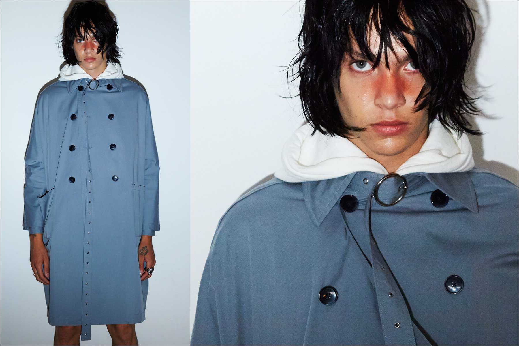 A male model poses in a trench coat, backstage at Private Policy S/S18. Photos by Alexander Thompson for Ponyboy magazine NY.