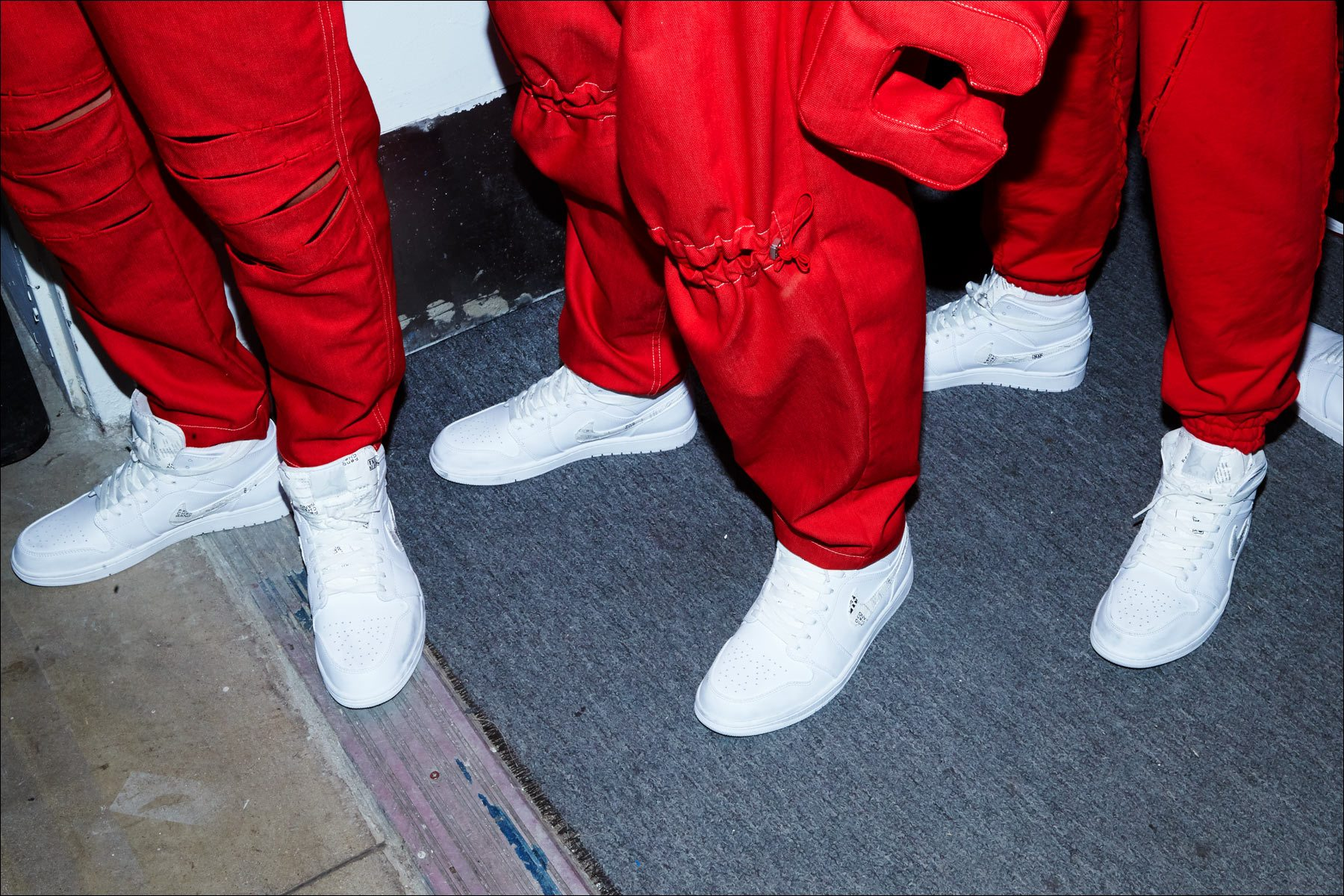 Detail shot of trousers and sneakers, backstage at Feng Chen Wang menswear. S/S18. Photography by Alexander Thompson for Ponyboy magazine NY.