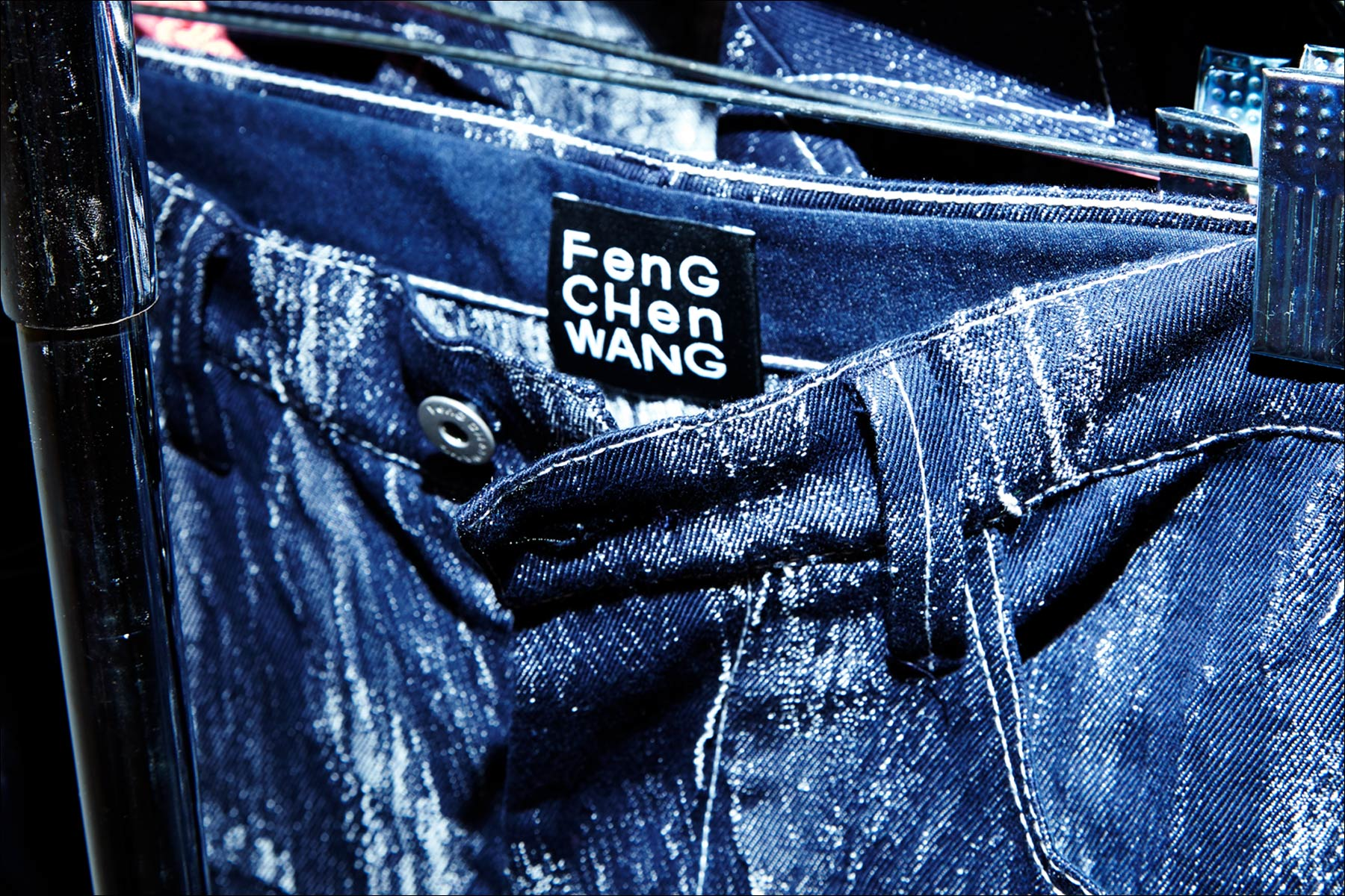 Closeup of jeans backstage at the Feng Chen Wang menswear show. Photographed by Alexander Thompson for Ponyboy magazine NY.