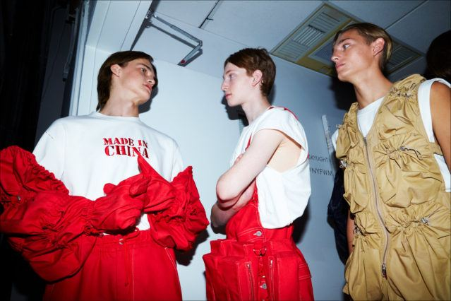 Models before walking backstage at Feng Chen Wang menswear. S/S18. Photography by Alexander Thompson for Ponyboy magazine.