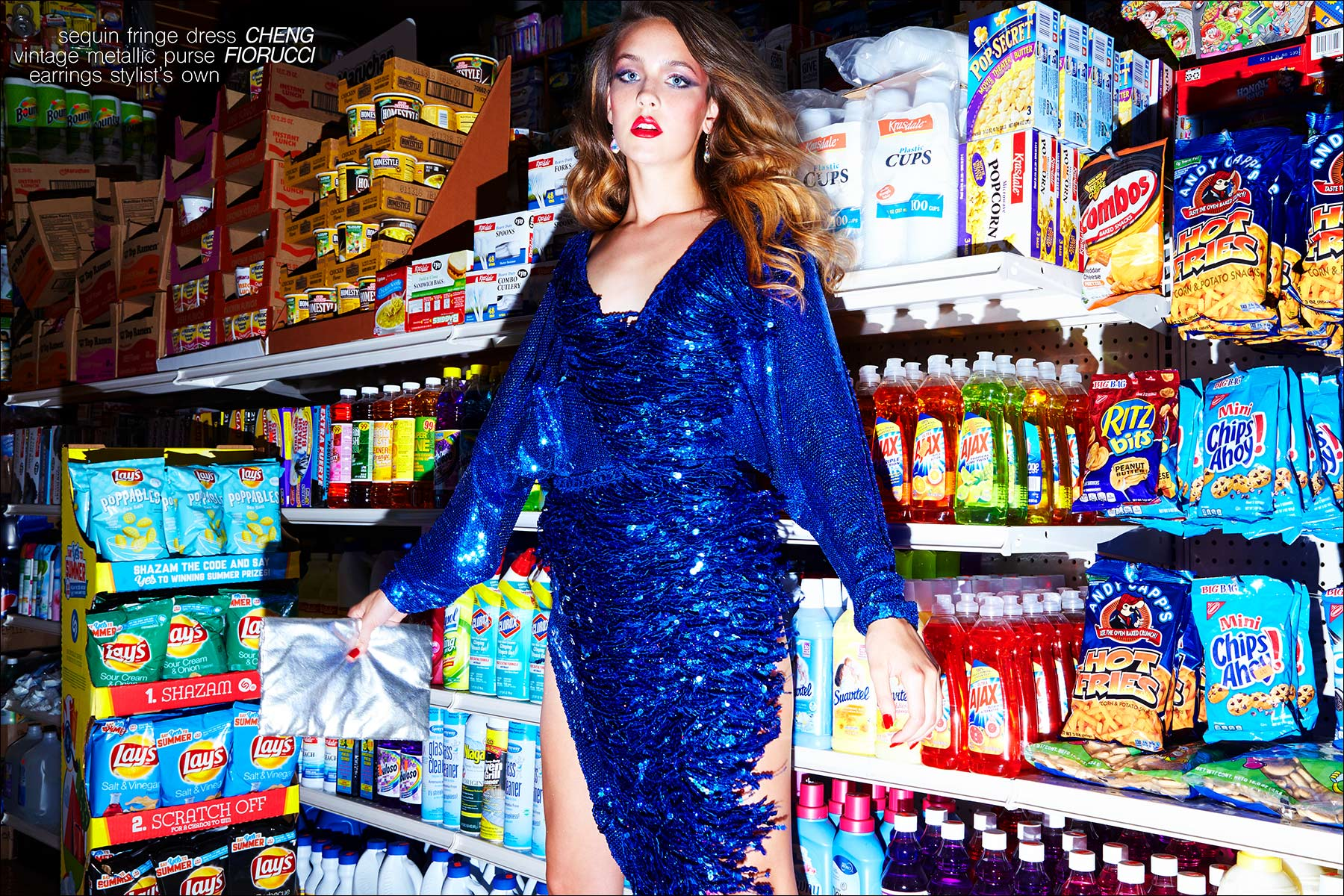 Izzy Pawline wears a sequined blue dress by Cheng, for Ponyboy magazine NY. Photographed by Alexander Thompson.